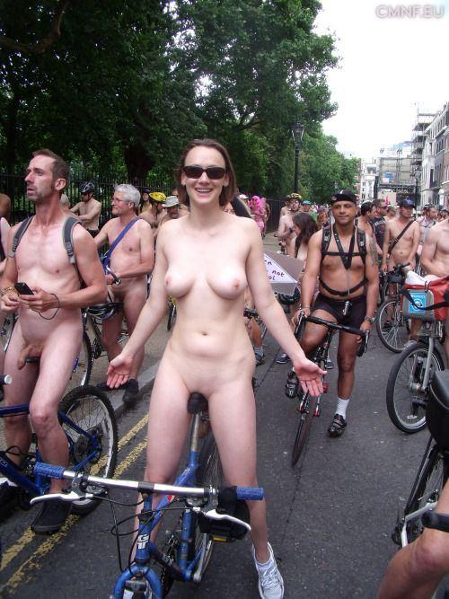 Nude girl riding bike