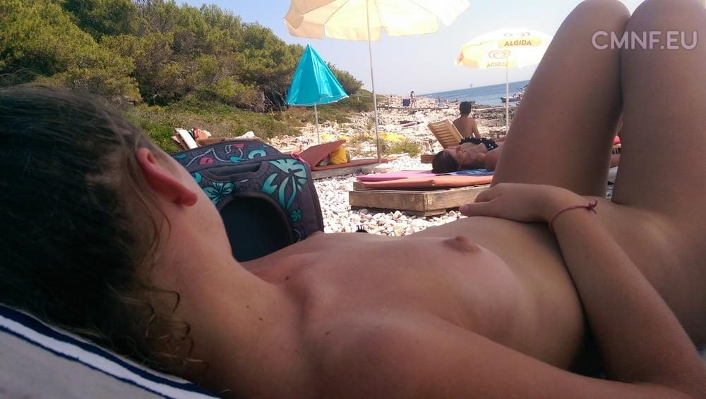Teen flashing on public beach